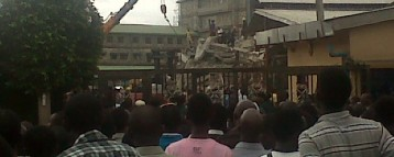 Woman walks out of TB Johsua's collapsed building