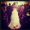Bride drags baby along the aisle with her wedding dress