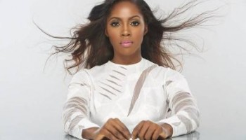 Tiwa Savage shows her gold plated iPhone 6 and mic