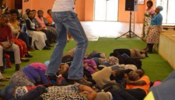 Pastor Lesego Climbs On Top Of His Members During Service